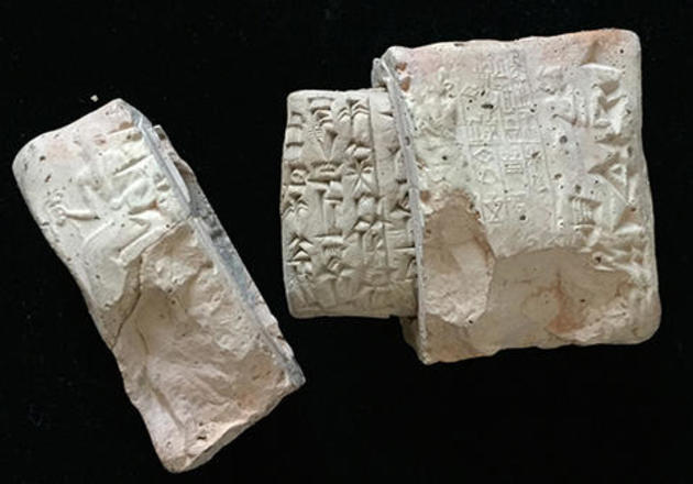 A cuneiform tablet in a a clay envelope, c. 2050 bce, is among the 42,000 inscribed documents from ancient Mesopotamia housed in the Yale Babylonian Collection.