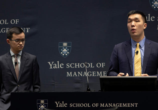 Yichen Zheng (left) and Sam Xue (right) from the Yale team give their pitch