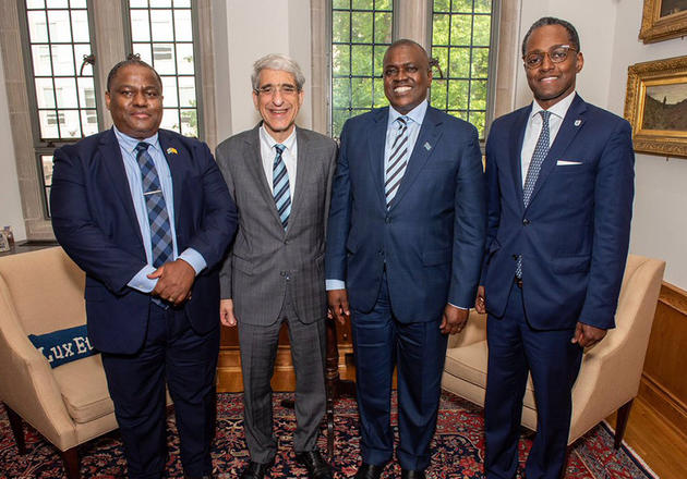 Left to right: Kefentse Mzwinila '99 M.A., Botswanan minister of land management, water and sanitation services; Yale President Peter Salovey; President Mokgweetsi Masisi of the Republic of Botswana; Yale Director for Africa Eddie Mandhry.