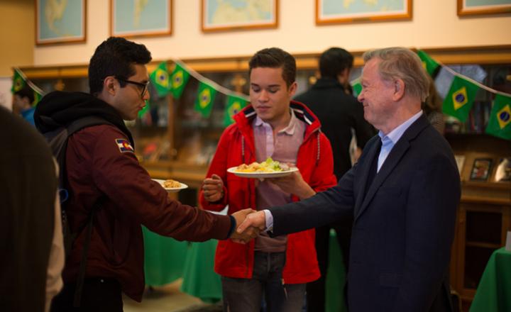 Professor David Jackson with students at the Brazil activities fair.